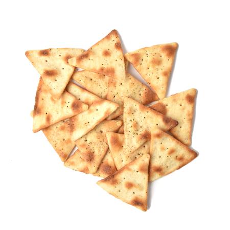 A mound of toasted, seasoned pita chips on a white background 版權商用圖片