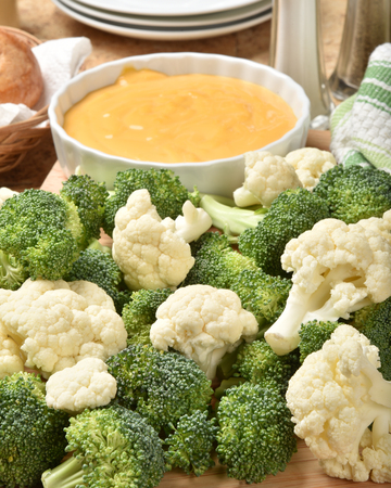 Cauliflower and broccoli florets wihth cheese dip