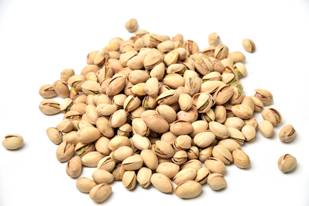 A large mound of pistachios on a white background 版權商用圖片