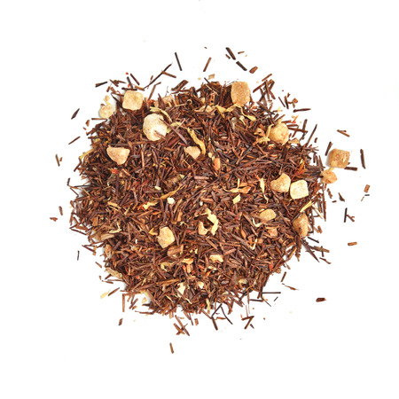rooibos: A mound of rooibos tea with bits of mango fruit
