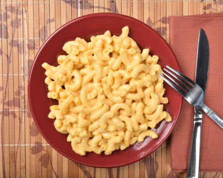 A plate of macaroni and cheese from an overhead view
