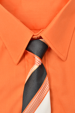Closeup of an orange shirt and necktie Imagens