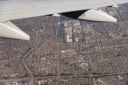 A city seen from the window of an airplane during takeoff Stock Photo