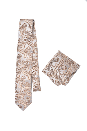 Beige paisley pattern tie and hanky on a white background Stock Photo