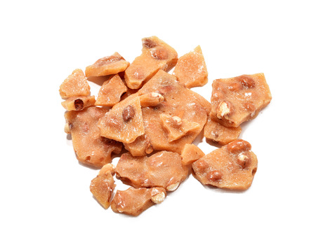 A mound of gourmet peanut brittle from an overhead view 版權商用圖片