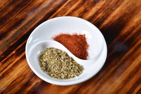 A spice dish with paprika and oregano Imagens