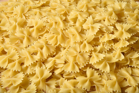 Farfalle or bowtie pasta background, overhead view Stock fotó