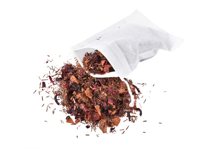 Strawberry kiwi infused rooibos tea on a white background