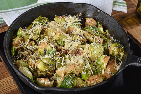 Grilled Brussels sprouts with parmesan cheese in a cast iron skillet