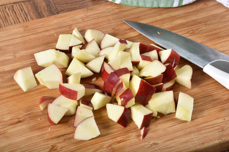 A mound of diced apples on a cutting board Stok Fotoğraf