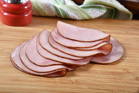 Thin slices of ham on a cutting board
