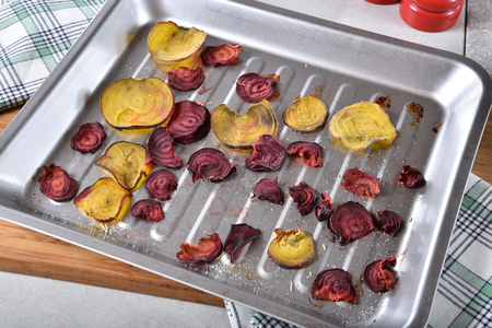 Overhead view of homemade beet chips in a baking pan