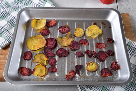 Home made beet chips in a baking pan.