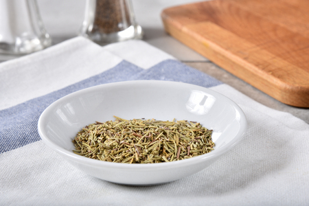 Close up of dried Rosemary in a spice dish.  Shallow depth of field.