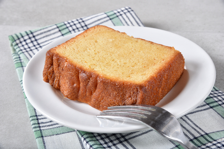 A slice of delicious moist pound cake on a plate