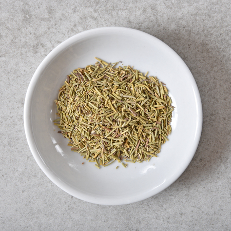 Overhead view of a bowl of dried Rosemary spice