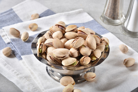 Small snack bowl of pistachio nuts