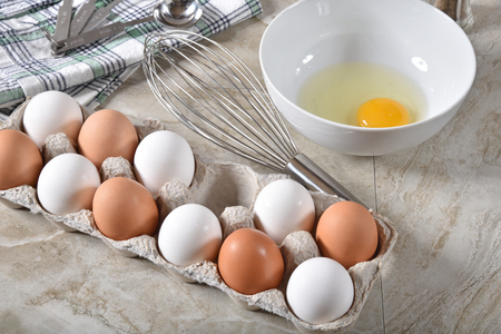 A carton of brown and white organic eggs