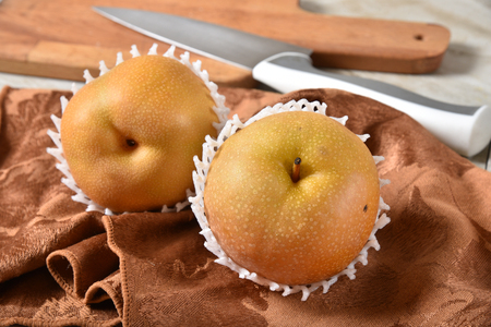 Delicious ripe apple pears, also known as Asian Pears and other names.  It is becoming a very trendy fruit. Imagens