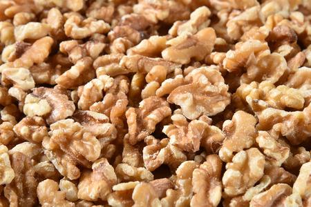 Macro shot of a mound of fresh shelled walnuts