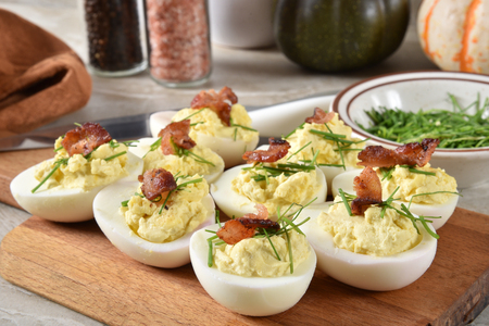 Deviled eggs with chives and bacon bits