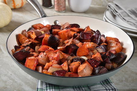 Beet and yam hash with onions in a skillet 写真素材