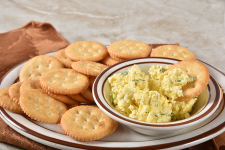 Gourmet crackers with deviled egg in a small dish