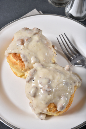 Overhead view of biscuits and gravy with sausage bits