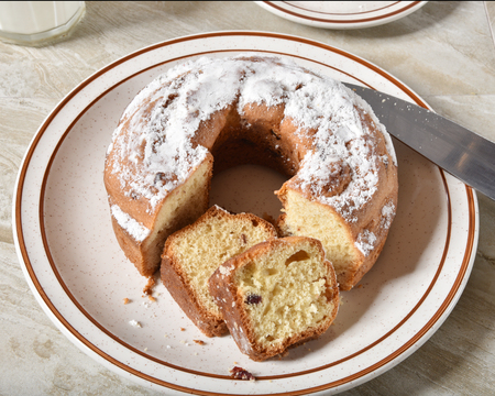 Overhead view of sliced cranberry bundt cake with powdered sugar