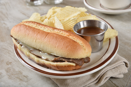 Steak and cheese submarine sandwich with beef and mozzarella cheese Stok Fotoğraf