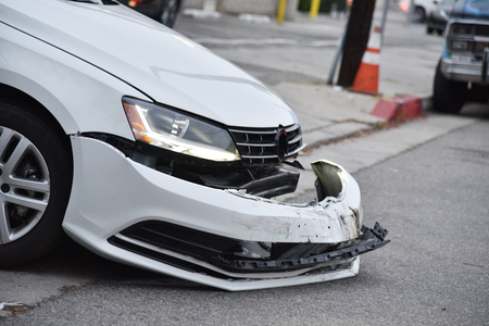A car with its bumper torn off after an acccident