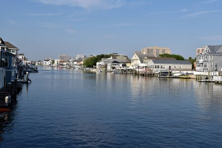 Luxury homes, boats and docks line a waterway near Atlantic City New Jersey