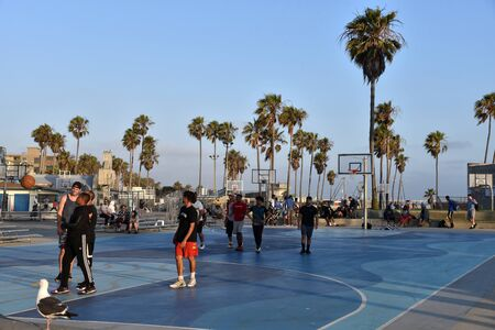 VENICE,  CA/USA - July 5, 2019:  People playing basketball at the Venice Beach basketball courts