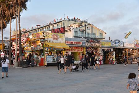 VENICE,  CA/USA - July 5, 2019: Kettle corn stand and shops on the Venice Beach Boardwalk