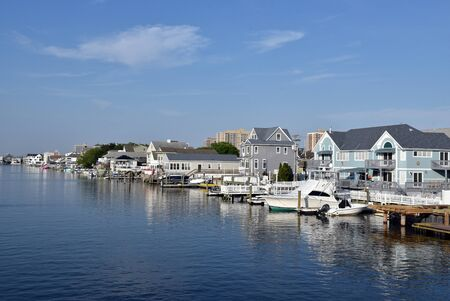 OCEAN CITY, NEW JERSEY/USA - JUNE 27, 2019: Luxury homes, boats and docks line a harbor in Margate NJ near Ocean City