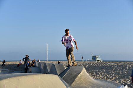 VENICE,  CA/USA - July 5, 2019: A skateboarder riding the wall at the Venice Beach skatepark