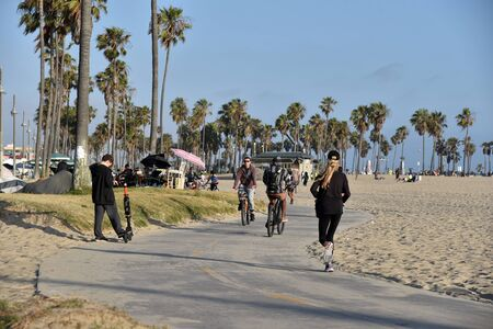 VENICE,  CA/USA - July 5, 2019: Bicyclists and scooters on the bike path at venice beach