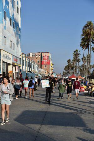 VENICE,  CA/USA - July 5, 2019:  Tourists enjoying the Venice Beach boardwalk on a summer day