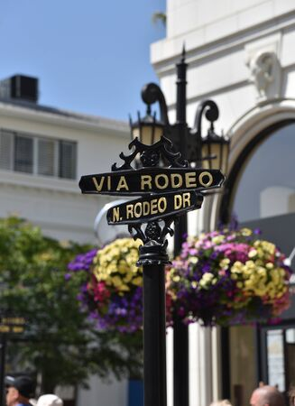 LOS ANGELES, CA/USA - July 8, 2019: Street sign for the famous intersection of Via Rodeo and Rodeo Drive in Beverly Hills.