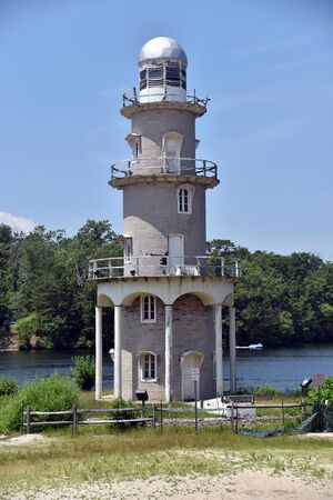 A rustic old lighthouse in Mays Landing New Jersey on the edge of Lake Lenape