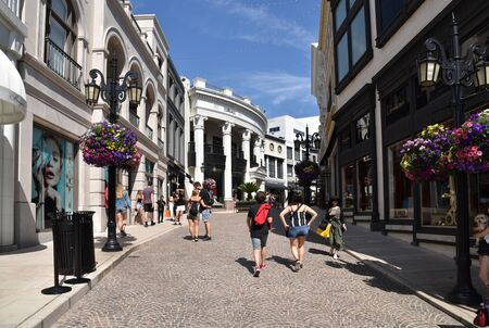 LOS ANGELES, CA/USA - July 8, 2019: Tourists and shoppers stroll along Via Rodeo Drive in Beverly Hills