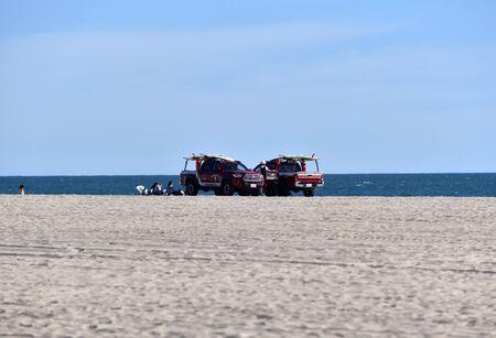 HUNTINGTON BEACH, CA/USA - MARCH 14, 2019: Lifeguard patrol on the beach on a sunny day Redactioneel