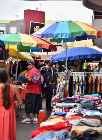 LOS ANGELES, CA/USA - JUNE 19, 2017:  Street vendors and bargain hunters crowd the Los Angeles Fashion District.