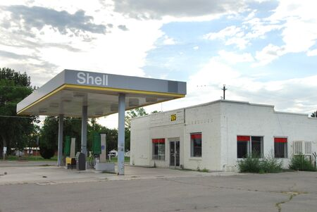 GREEN RIVER, UT/USA - JULY 10, 2012: An abandoned Shell Oil gas station.  The town was economically devastated when I-70 bypassed it.