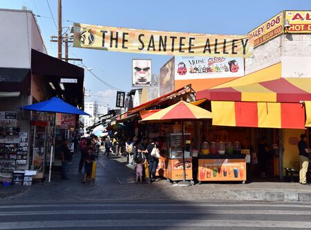 LOS ANGELES, CA/USA - JUNE 19, 2017: Shoppers and vendors fill the famous Santee Alley in the Los Angeles Fashion District.