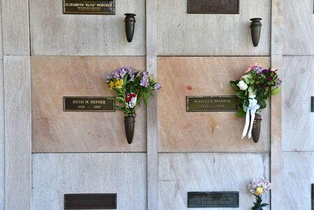 LOS ANGELES, CA/USA - MARCH 15, 2019: Marilyn Monroe and Hugh Hefner Graves side by side at Pierce Brothers Westwood Village Memorial Park