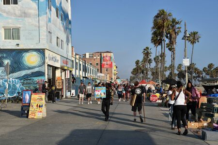 VENICE,  CA/USA - July 5, 2019: Crowds on the Venice Beach boardwalk on the Fourth of July Weekend