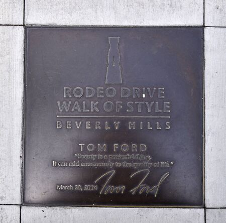 LOS ANGELES, CA/USA - July 8, 2019: Bronze plaque honoring fashion designer Tom Ford on the Rodeo Drive Walk of Style