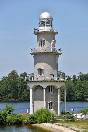 The old lighthouse at Lake Lenape in Mays Landing New Jersey is a landmark. Scenic landscape photography. 写真素材 - 128448677
