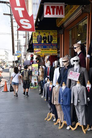 LOS ANGELES, CA/USA - JUNE 19, 2017: Mannequins with suits line the sidewalk of the menswear section of the Los Angeles Fashion District.